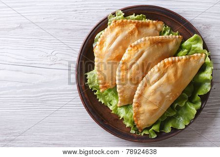 Stuffed Empanadas On A Plate. Horizontal View From Above