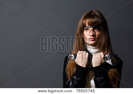 Girl In Safety Glasses With Adjustable Wrench On A Dark Background
