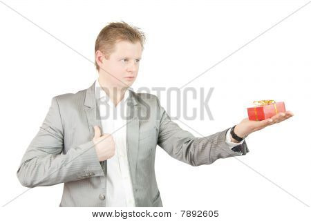 Businessman Holding Out A Present Box