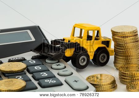 cost accounting in the construction industry and the construction industry. higher higher prices for road and residential construction. excavator with coins and calculator