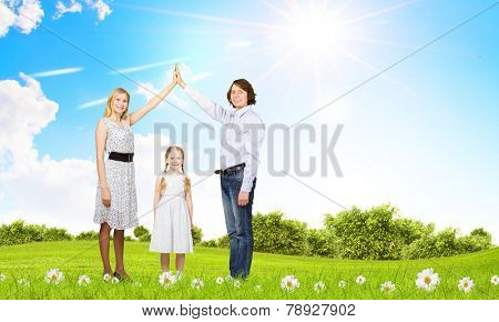 Happy family of three dreaming about home