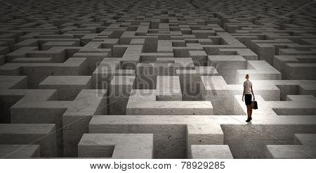 Puzzled businesswoman standing on top of labyrinth