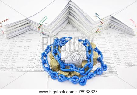 Blue Plastic Chain Shackle House And Pile Of Gold Coins