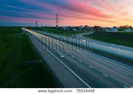 Highway traffic in sunset