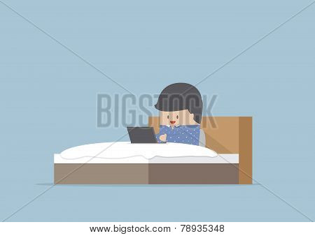 Man Working On His Laptop In The Bed