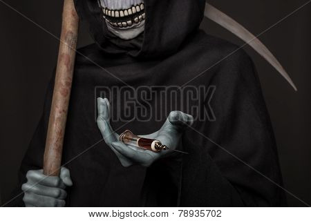 The concept: drugs kill. Angel of death holding syringe with heroin