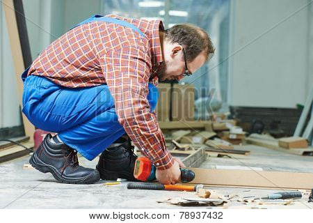 Carpenter worker preparing door frame for indoor installation