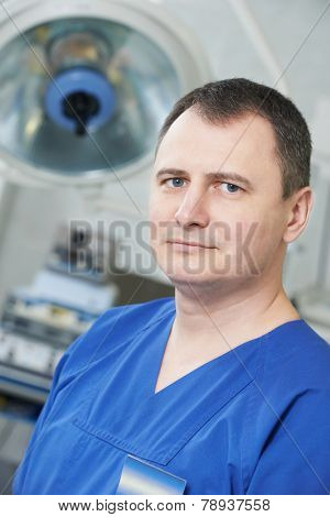 Portrait of surgeon or doctor in uniform at cardiological operation room in cardiac surgery clinic