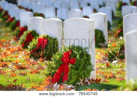 Gravestones with Christmas wreaths in Arlington National Cemetery - Washington DC United States