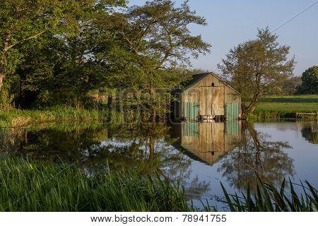 Boathouse with reflection