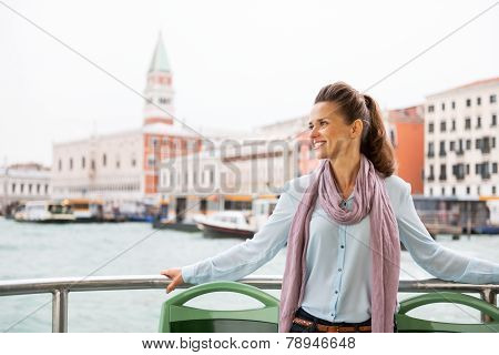 Smiling Young Woman Travel By Vaporetto In Venice, Italy