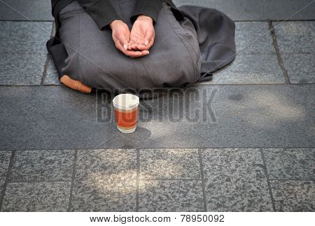 Begging hands on the street
