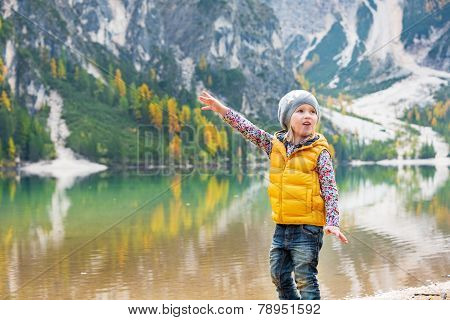 Child Pointing On Copy Space While On Lake Braies In South Tyrol