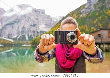 Closeup On Young Woman Taking Photo On Lake Braies In South Tyro