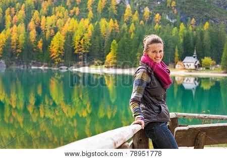 Young Woman Looking On On Lake Braies In South Tyrol, Italy
