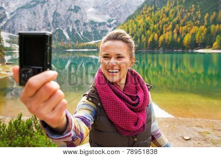 Smiling Young Woman Taking Self Photo On Lake Braies In South Ty
