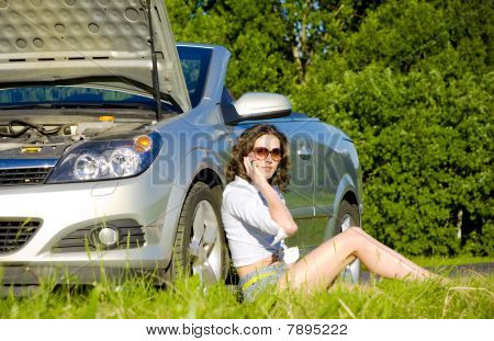 Young Woman Is Calling To Service Near Broken Car