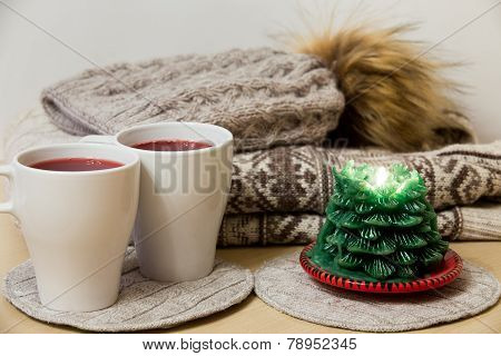 Winter Clothes, Two Cups Of Mulled Wine And Candle