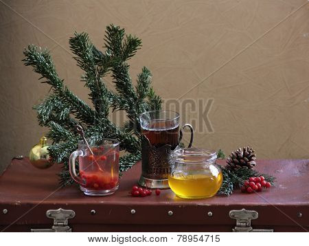Still-life with tea, honey and a guelder-rose