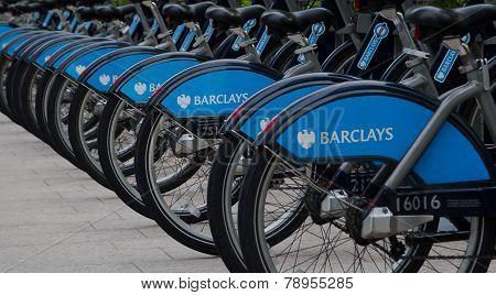 LONDON, UK - APRIL 21, 2014: Boris bikes parking on business Canary Wharf, sponsored by Barkley's