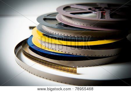Pile Of 8Mm Super8 Movie Reels With Color Effect And Out Of Focus Background