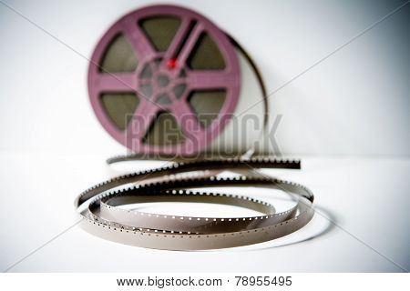8Mm Super8 Film Detail With Purple Reel Out Of Focus In Background