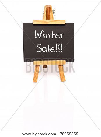 Winter Sale. Blackboard with text and easel.
