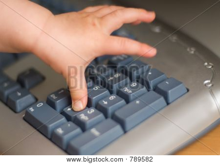 baby's hand on keyboard