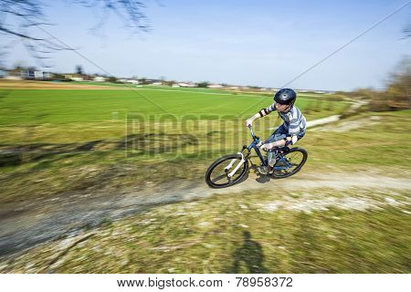 Teenage Boy Racing With His Dirt Bike