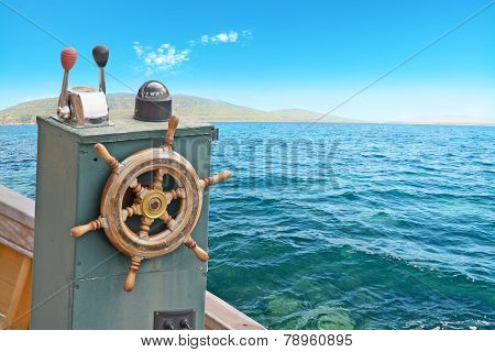 Close Up Of A Boat Wheel On The Water