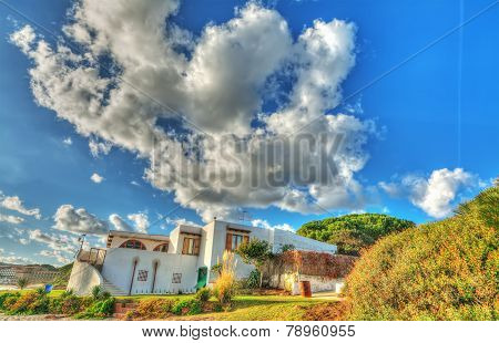 Huge Clouds Over A Beach House