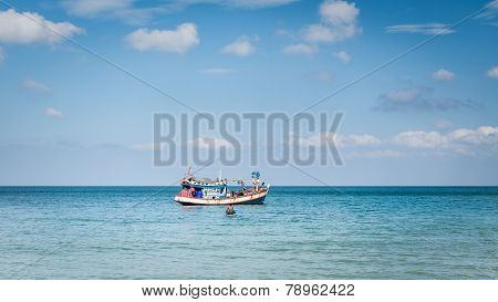 Fisherman With His Fishing Boat On The Sea