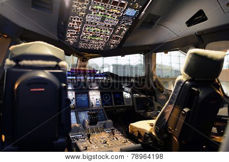 HONG KONG, CHINA - DEC 10, 2014: cockpit interior in Emirates Airbus A380 after landing on December 10, 2014. Emirates is the largest airline in the Middle East