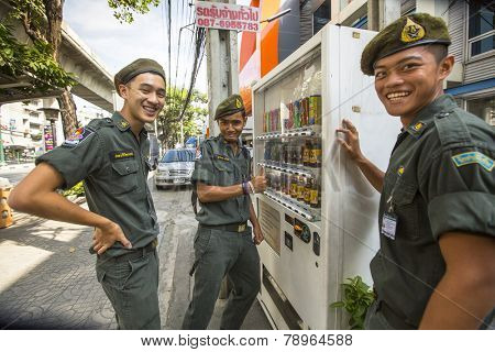 BANGKOK, THAILAND - DEC 17, 2014: Unidentified young Thai soldiers on a street in the city center. Military service runs on a contract (65%) and mandatory system. Draft age - 20-55 years.