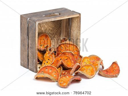 Slices Of Dried Bael Fruit With Wooden Box.
