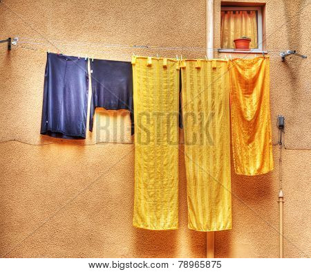 Yellow And Blue Clothes Hanging On A Laundry Line In Hdr