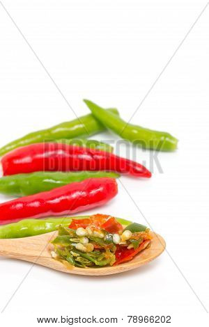 Chopped Chili On Wooden Spoon With Green And Red Chili Isolated On White.