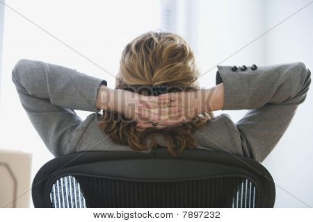 Businesswoman Relaxing in Office Chair