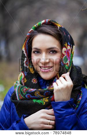 Russian beauty woman in the national patterned shawl