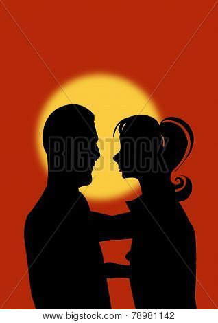 Young Couple At Sunset Silhouette