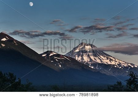 Mountain Landscape Of Kamchatka: Evening View Of Viluchinsky Volcano And Moon