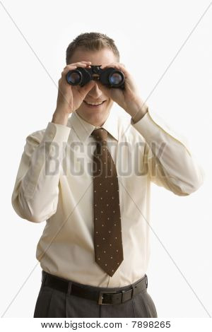 Businessman Looking Through Binoculars - Isolated