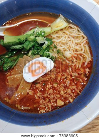 Closed Up Ramen With Spicy Sauce And Pork
