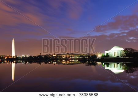 Washington DC - Thomas Jefferson Memorial  and Washington Monument at night with mirror reflections on water.