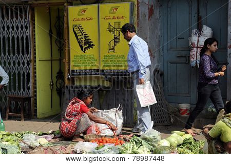 KOLKATA, INDIA - FEBRUARY 12: Street trader sell vegetables outdoor on February 12, 2014 in Kolkata India. Only 0.81% of the Kolkata's workforce employed in the primary sector (agriculture)