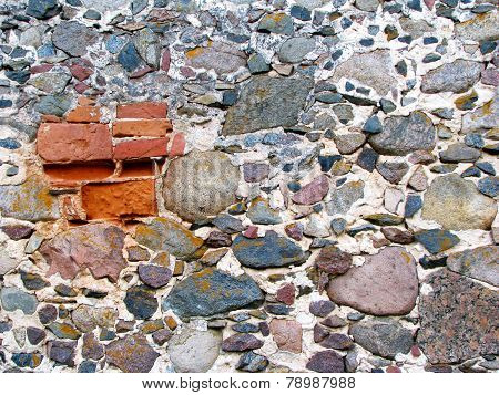 Old Rock Wall With Red Bricks