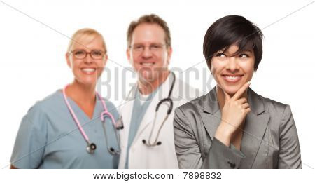 Young Multiethnic Woman And Doctors