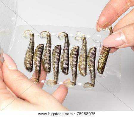 Silicone Baits In Female Hands