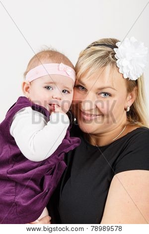 Loving Mother Embracing Her Baby Girl