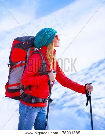 Happy skier girl enjoying view on beautiful mountains covered with snow, active lifestyle, luxury ski resort, winter sport concept